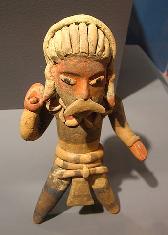 Ballplayer holding a stone for striking (c. 3rd - 5th century AD) - The Mesoamerican Ball Game