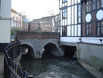 "Kingston upon Thames - The Hogsmill flowing under Clattern Bridge in Kingston. The bridge is mentioned in 1293 as ""Clateryngbrugge"""