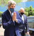 Climate Envoy John Kerry greets after arriving India.png