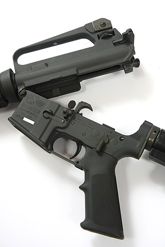 Colt AR-15 - AR-15A2 with the upper and lower receiver opened at the front hinge.