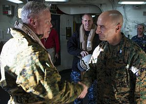 26th Marine Expeditionary Unit - Gen. James Amos, commandant of the Marine Corps meets with Col. Matt St. Clair, 26th MEU commanding officer to discuss further plans regarding Hurricane Sandy disaster relief.