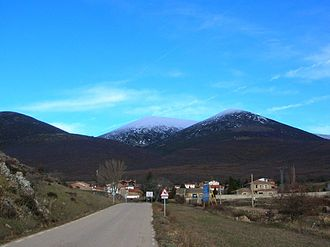 Moncayo Massif - View of Cueva de Ágreda town with the massive three summits of the Moncayo in the background