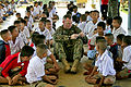 Defense.gov News Photo 110118-M-9683P-397 - U.S. Marine Corps Capt. Alistair E. Howard interacts with children during exercise Cobra Gold at Baan Pong Wua School in Chantaburi province.jpg