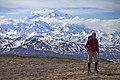 Denali looms out of the clouds for a hiker in Denali (c43c99fd-20de-4720-bb20-f79c6ea3409a).jpg