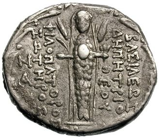 Atargatis - The reverse of a coin of Demetrius III depicts fish-bodied Atargatis, veiled, holding the egg, flanked by barley stalks.