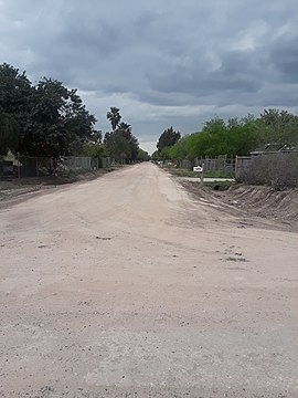 Colonia in the Rio Grande Valley near the Mexico-United States border Dirt road texas.jpg