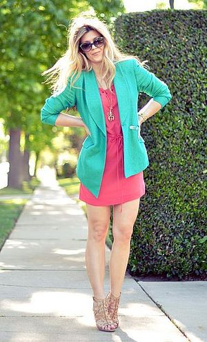 Blazer - Woman wearing a teal blazer.