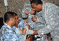 Drilling Iraqi police on core medic skills DVIDS211176.jpg