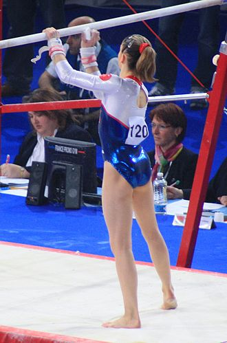 Uneven bars - Youna Dufournet preparing the bars with chalk
