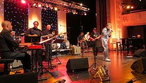 TCB Band - TCB Band 2013 at 12th European Elvis Festival in Bad Nauheim: Glen Hardin (p), Ron Tutt (d), James Burton (g), and Austrian singer Dennis Jale