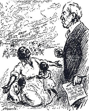 "East St. Louis riots - Political cartoon about the East St. Louis massacres of 1917. The caption reads, ""Mr. President, why not make America safe for democracy?"", referring to Wilson's catch-phrase ""The world must be made safe for democracy"" (depicted on the document he holds)."