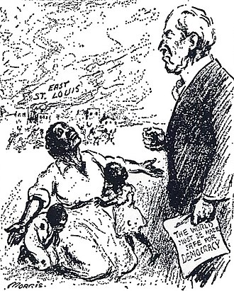 "East St. Louis Race Riots - Political cartoon about the East St. Louis massacres of 1917. The caption reads, ""Mr. President, why not make America safe for democracy?"", referring to Wilson's catch-phrase: ""The world must be made safe for democracy"" (shown on the document he holds)."