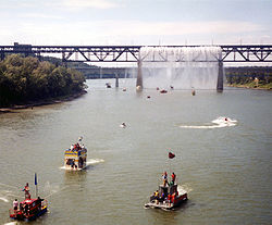 2001 Sourdough Raft Race, passing beneath the High Level Bridge's Great Divide waterfall during Klondike Days.
