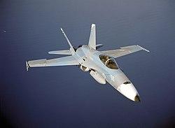 F-18 overflying water - (USN, USDoD).jpg