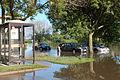 FEMA - 44986 - Flood Survivor searches for belongings in Iowa.jpg