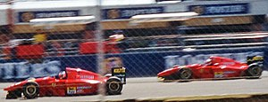 The 1994 Ferrari 412 T1s during the British Grand Prix, driven by Gerhard Berger (left) and Jean Alesi.