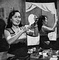Fifi Young doing her make-up, Film Varia 2.3 (March 1955), p23.jpg