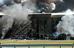 Firefighters work to put out the flames moments after a hijacked jetliner crashed into the Pentagon at approximately 0930 on September 11, 2001 010911-M-CI426-053.jpg