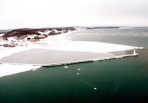 Frankfort, Michigan - The harbor entrance to Frankfort is completely frozen over in February 1994.