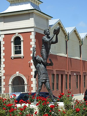 "Spectacular mark - Statue by Robert Hitchcock outside Fremantle Oval of South Fremantle's John Gerovich taking a ""specky"" over East Fremantle's Ray French in the 1956 WANFL preliminary final"