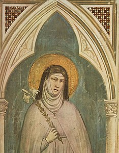 Fresco depicting Clare of Assisi holding a lily.jpg