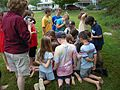 Gathered around the collection bucket (4741796231).jpg