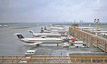 Planes lined up at a terminal
