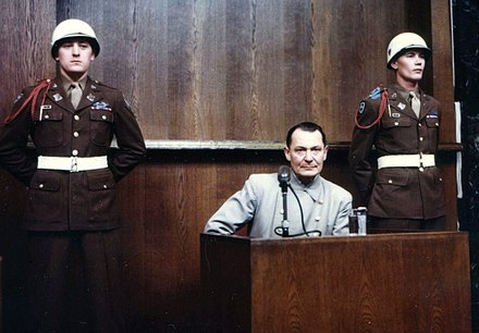 Hermann Goring under cross-examination Goering on trial (color).jpg