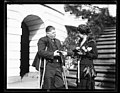 Grace Coolidge and unidentified man with crutches at White House, Washington, D.C. LCCN2016892782.jpg