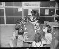 Granada Relocation Center, Amache, Colorado. Milk and graham crackers served to nursery school chil . . . - NARA - 539002.tif