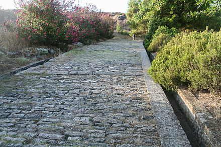 The Porta Rosa, a Greek street dating from the 3rd to 4th century BC in Velia, with a paved surface and gutters Greek street - III century BC - Porta Rosa - Velia - Italy.JPG