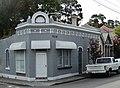 Grey building on the corner in Newtown (12869491625).jpg