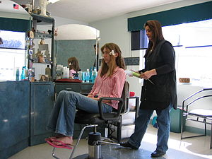 English: Girl getting her hair done