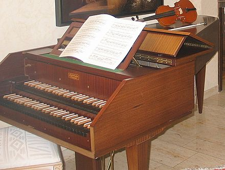 A modern harpsichord with two manuals (keyboards).  It is a copy of a Baroque instrument.