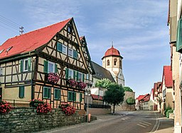 The main street through Oberriexingen in Baden-Württemberg (Germany) with the Church of St. George.