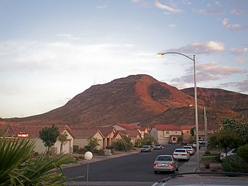A view of Black Mountain above Henderson, Nevada. Black Mountain is one of the more prominent of those in the  Mccullough Range and its peak is the site of much of the radio and television transmission towers for the Las Vegas metropolitan area.