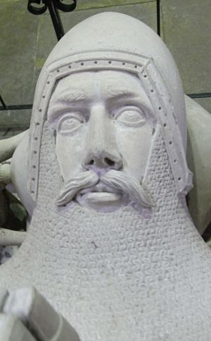Hugh de Courtenay, 2nd/10th Earl of Devon - Effigy (restored) of Hugh de Courtenay, 2nd/10th Earl of Devon,  south transept, Exeter Cathedral