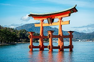 The torii o Itsukushima Shrine, the steid's maist recognizable laundmerk, appears tae float in the watter.
