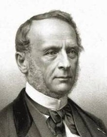 Black and white photo of a man wearing formal dress, head and shoulders seen in half right profile