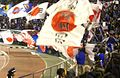 Japan national football team fans with rising sun flag.JPG