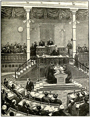 Meiji period - Interior of National Diet, showing Minister speaking at the tribune from which members address the House.