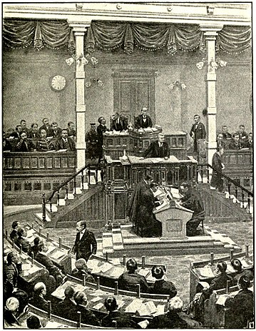 Interior of the Japanese Parliament, showing the Prime Minister speaking at the tribune from which members address the House, 1915 Japanese Parliament in session.jpg