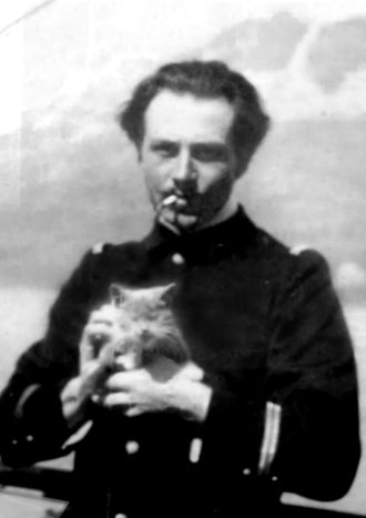Jean Cras - Jean Cras at sea in his naval uniform with his cat, Bleu-Nial, 1902.
