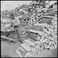 Jerome Relocation Center, Dermott, Arkansas. Evacuees at the Jerome Relocation Center chop their ow . . . - NARA - 538198.jpg