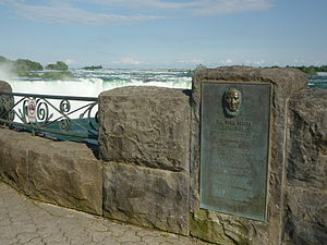 "José María Heredia y Heredia - Monument to Heredia at the Niagara falls. The text ""Cuban poet, exiled patriot called the sublime singer of the wonderous greatness of Niagara falls."" is inscribed at the monument."