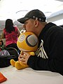 Josh Grelle with Kururu plush - San Japan.JPG