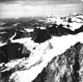 Juneau Icefield, bergschrund and icefield surrounded by aretes, August 30, 1971 (GLACIERS 6358).jpg