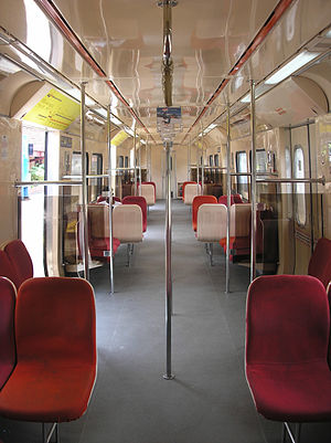 KTM Komuter Northern Sector - The (modified—with additional handle bars) interior of a Class 83 EMU train.