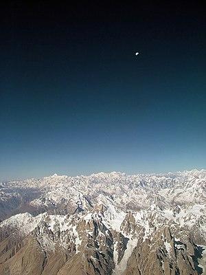 View of the moon over Karakoram Range in Pakistan