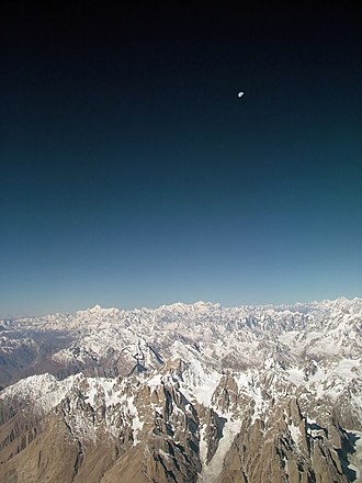Karakoram - View of the moon over Karakoram Range in Pakistan